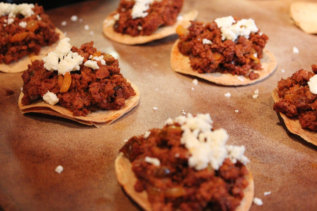 chocolate bell peppers, chorizo, onions, tostadas, cotija cheese