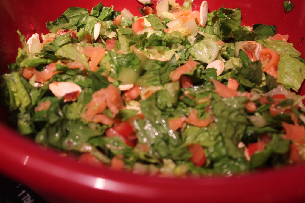 chopped salad, smoked salmon, kale, roasted parsnips, romaine lettuce, tomatoes, couscous, peach vinaigrette, parmesan cheese