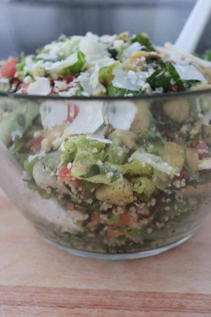 chopped salad, smoked salmon, kale, roasted parsnips, romaine lettuce, tomatoes, couscous, peach vinaigrette