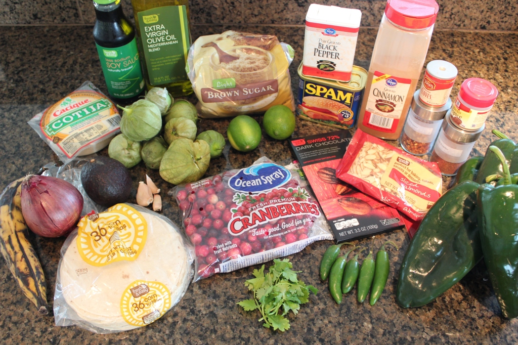 ingredients, spam tacos, cranberry mole, serrano chilies, pasilla peppers, tomatillos, cranberries, dark chocolate, spam, corn tortillas, cilantro, cojita cheese, plantains
