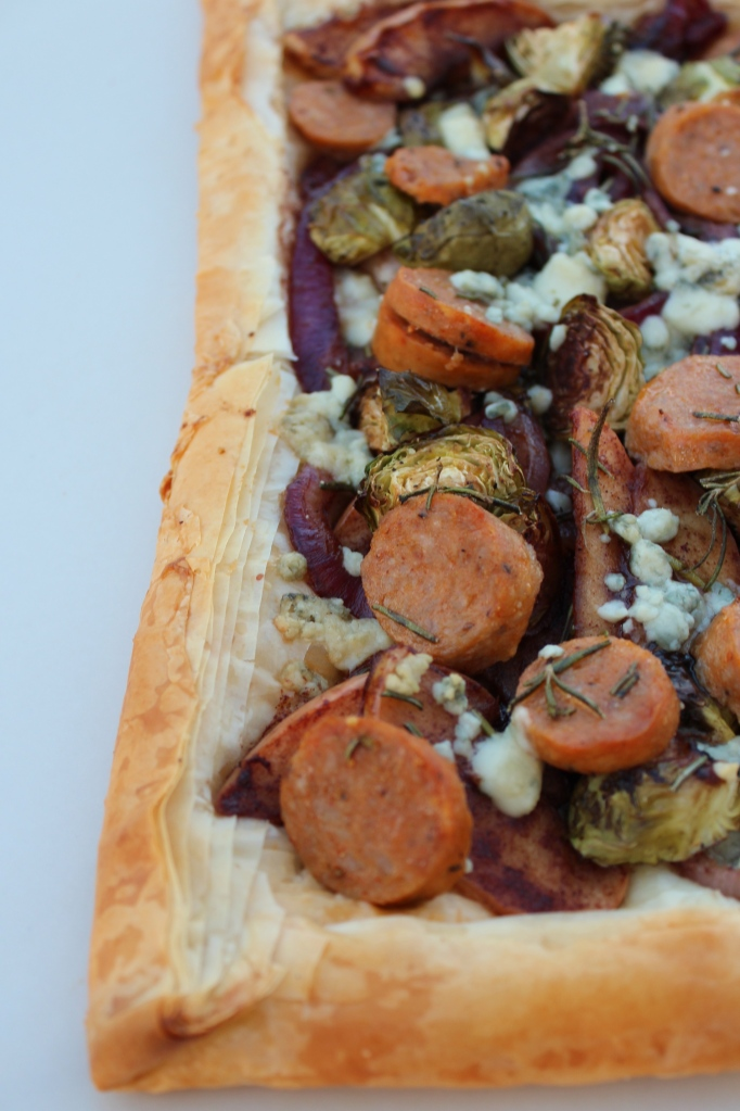 caramelized apples, caramelized onions, sweet italian sausage, roasted garlic brussels sprouts, gorgonzola cheese, rosemary, phyllo dough crust, tart